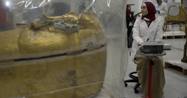 The gold-covered sarcophagus of King Tutankhamun is encased in a tent for restoration procedures at the conservation center of the the Grand Egyptian Museum in Giza, near Cairo, Egypt, Sunday, Aug. 4, 2019.