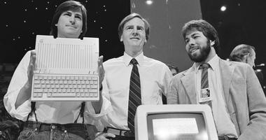 In this April 24, 1984 file photo, Steve Jobs, left, chairman of Apple Computers, John Sculley, center, president and CEO, and Steve Wozniak, co-founder of Apple, unveil the new Apple IIc computer in San Francisco, Calif.