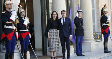New Zealand Prime Minister Jacinda Ardern, center left, is greeted by French President Emmanuel Macron, center right, as she arrives at the Elysee Palace, in Paris, Wednesday, May 15, 2019.