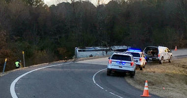 Emergency personnel work at the scene where a charter bus that was carrying a youth football team from Tennessee crashed early Monday, Dec. 3, 2018, near Benton, Ark.