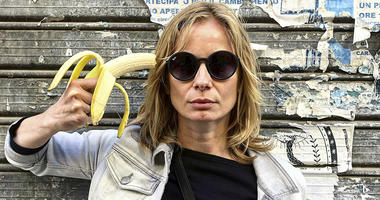 Polish actress Magdalena Cielecka aims a banana like a gun at her head to protest the removal of an art work from the National Museum in Warsaw that features a woman eating a banana with visible pleasure, which the conservative authorities say is obscene.