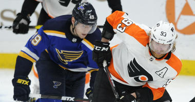 Philadelphia Flyers' Jakub Voracek (93), of Czech Republic, skates by St. Louis Blues' Ivan Barbashev (4(), of Russia, during the second period of an NHL hockey game, Thursday, April 4, 2019, in St. Louis.
