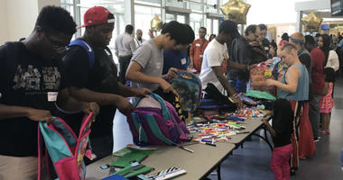 Students from the Community College of Philadelphia collected school supplies to give to local elementary students and their teachers.