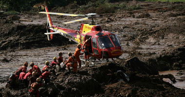 Firefighters are resupplied as they search for victims of a dam collapse in Brumadinho, Brazil, Monday, Jan. 28, 2019.