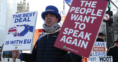 Anti Brexit protester Steve Bray who is almost permanently demonstrating outside the Houses of Parliament watches the traffic as he holds up placards in London, Monday, Jan. 28, 2019.