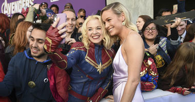 """Brie Larson takes a selfie with a fan as she arrives at the premiere of """"Avengers: Endgame"""" at the Los Angeles Convention Center on Monday, April 22, 2019."""