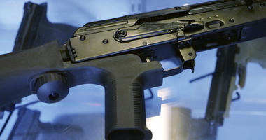 """This Oct. 4, 2017 file photo shows a device called a """"bump stock"""" attached to a semi-automatic rifle at a gun store and shooting range in Utah."""