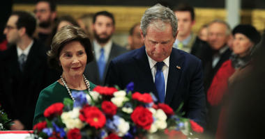 Former President George W. Bush and former first lady Laura Bush pay their respect to his father former President George H.W. Bush as he lie in state at the U.S. Capitol in Washington, Tuesday, Dec. 4, 2018.