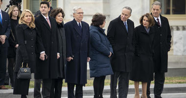 Janna Ryan, Paul Ryan, Elaine Chao, Mitch McConnell, Iris Weinshall, Chuck Schumer, Nancy Pelosi and Paul Pelosi await the departure of the flag-draped casket of the late former President George H.W. Bush at the U.S. Capitol, December 5, 2018.