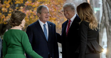 President Donald Trump and first lady Melania Trump are greeted by former President George Bush and former first lady Laura Bush outside the Blair House across the street from the White House in Washington, Tuesday, Dec. 4, 2018.