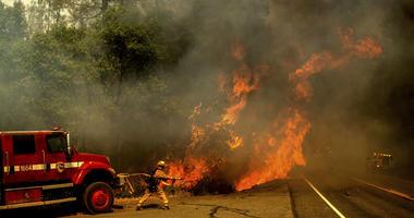A firefighter battles the Carr Fire as it burns near Shasta, Calif., on Thursday, July 26, 2018.