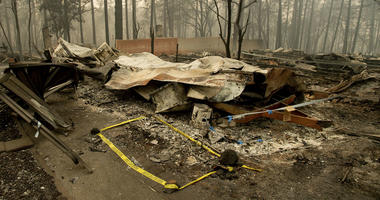 Tape marks a spot where sheriff's deputies recovered the body of a Camp Fire victim on Wednesday, Nov. 14, 2018, in Paradise, Calif.