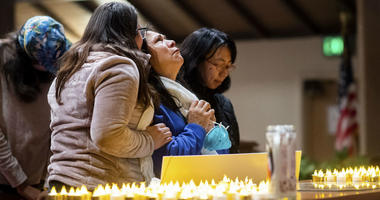 Lidia Steineman, who lost her home in the Camp Fire, prays during a vigil for fire victims on Sunday, Nov. 18, 2018, in Chico, Calif.