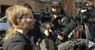 In this Tuesday, March 5, 2019 photo, Chelsea Manning addresses the media outside federal court in Alexandria, Va.