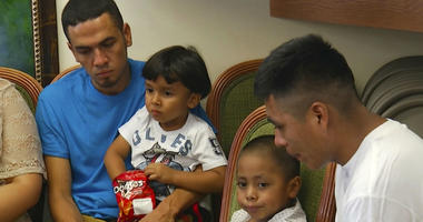 In this image taken from video, Javier Garrido Martinez, left and Alan Garcia, right, sit with their 4-year-sons at a news conference in New York, Wednesday, July 11, 2018.
