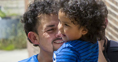 Ever Reyes Mejia is reunited with his 3-year-old son at the U.S. Immigration and Customs Enforcement (ICE)  office building in Grand Rapids, Mich., on Tuesday, July 10, 2018.