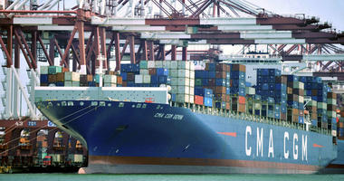 In this July 6, 2018, file photo, a container ship is docked at a port in Qingdao, in eastern China's Shandong Province.