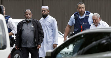 Police escort men from a mosque in central Christchurch, New Zealand, Friday, March 15, 2019.