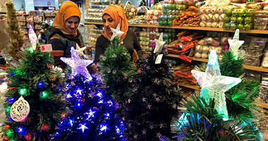 Iraqis shop for Christmas decorations in Baghdad, Iraq, Monday, Dec. 24, 2018. Although the number of Christians has dropped in Iraq, Christmas a national holiday, is very popular in the capital.