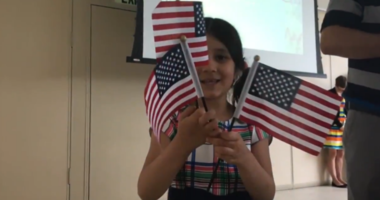Fifty immigrants who took the oath of citizenship at the Free Library of Philadelphia.