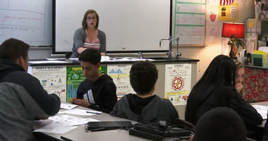 In this April 25, 2019, photo, science teacher Sarah Ott speaks to her class about climate literacy in Dalton, Ga.