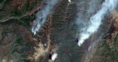 416 Fire, right, and the Burro Fire, left, northwest of Durango, Colo.