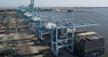 In this May 10, 2019, file photo a container ship is unloaded at the Virginia International Gateway terminal in Norfolk, Va.