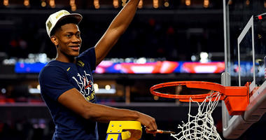 Virginia Cavaliers guard De'Andre Hunter (12) cuts down the net after beating the Texas Tech Red Raiders in the championship game of the 2019 men's Final Four at US Bank Stadium in Minneapolis.