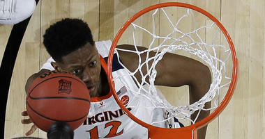 Virginia's De'Andre Hunter (12) goes up for a basket during the first half in the championship of the Final Four NCAA college basketball tournament against Texas Tech, Monday, April 8, 2019, in Minneapolis.