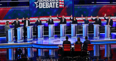 Democratic presidential candidates, Marianne Williamson, John Hickenlooper, Andrew Yang, Pete Buttigieg, Joe Biden, Bernie Sanders, Kamala Harris, Kirsten Gillibrand, Michael Bennet, Eric Swalwell, are shown during a Democratic primary debate.
