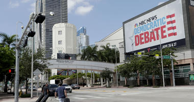 In this June 24, 2019, photo, a billboard advertises the Democratic Presidential Debates across from the Knight Concert Hall at the Adrienne Arsht Center for the Performing Arts of Miami-Dade County, in Miami.