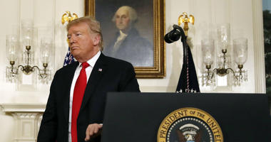 President Donald Trump leaves the podium after speaking about the partial government shutdown, immigration and border security in the Diplomatic Reception Room of the White House, in Washington, Saturday, Jan. 19, 2019.