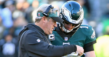 Philadelphia Eagles head coach Doug Pederson and Philadelphia Eagles quarterback Carson Wentz (11) go over a play late in the fourth quarter against the Carolina Panthers at Lincoln Financial Field.