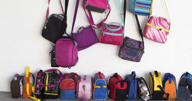 Colorful backpacks in a school