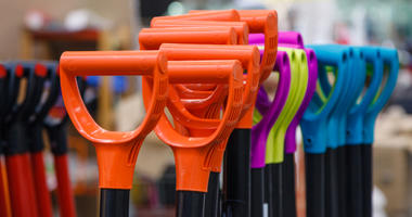 Colored plastic handle shovels in the store building tools.