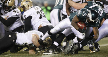 Philadelphia Eagles running back LeSean McCoy dives through the heart of the New Orleans Saints' defensive line to score a 1-yard touchdown in the third quarter during the NFC Wild Card Game on Saturday, Jan. 4, 2014, at Lincoln Financial Field.