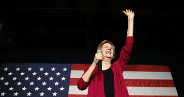 In this Jan. 5, 2019, file photo, Sen. Elizabeth Warren, D-Mass, waves to the crowd during an organizing event at Curate event space in Des Moines, Iowa.