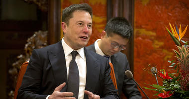 In this Jan. 9, 2019, file photo, Tesla CEO Elon Musk speaks during a meeting with Chinese Premier Li Keqiang at the Zhongnanhai leadership compound in Beijing.