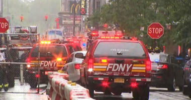 The FDNY responds to a helicopter crash on the roof of a Midtown building in New York City.