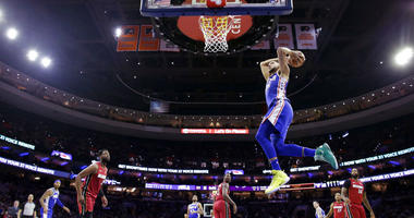 Philadelphia 76ers' Ben Simmons goes up for a dunk during the first half of the team's NBA basketball game against the Miami Heat, Thursday, Feb. 21, 2019, in Philadelphia.