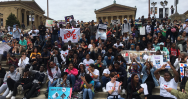 On Monday, scores of those victims' families and friends filled the Philadelphia Museum of Art steps with pictures and signs, calling for policy and cultural changes.
