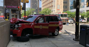 An eye witness tells me a woman trying to beat the light at 21st and Market slammed into this fire department vehicle, which hit a pedestrian before slamming into the building