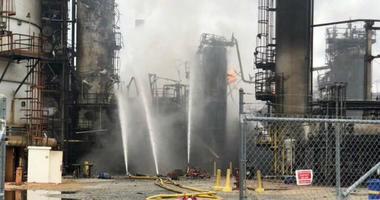 At the scene of an explosion at a Southwest Philadelphia refinery, the resulting fire is contained but not yet under control.