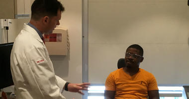 Philip Storey (left) performed surgery on Rasaan Urquhart's (right) eye at Wills Eye Hospital back in February following a fireworks incident. Storey warns of the dangers of shooting off fireworks, especially during the Fourth of July.