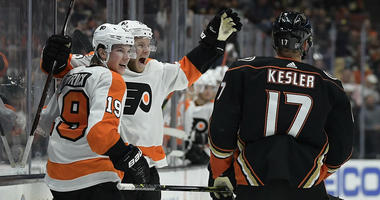 Philadelphia Flyers center Nolan Patrick, left, celebrates his goal with center Claude Giroux as Anaheim Ducks center Ryan Kesler (17) skates by.
