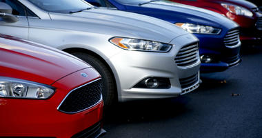 In this Nov. 19, 2015, photo, a row of new Ford Fusions are for sale on the lot at Butler County Ford in Butler, Pa.