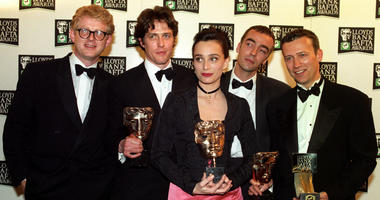 "The cast of ""Four Weddings and a Funeral"" celebrates its British Academy Film Awards win in 1994 in London.The cast has reunited for a short sequel that will air as part of Red Nose Day on May 23 on NBC."