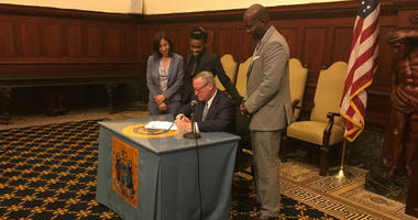 Mayor Jim Kenney signed two bills Wednesday removing gender language from two key city tax laws.