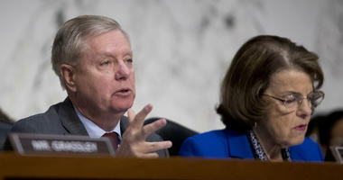 Senate Judiciary Committee Chairman Lindsey Graham, R-S.C., accompanied by Ranking Member Sen. Dianne Feinstein, D-Calif., right, questions Attorney General nominee William Barr in Washington, Tuesday, Jan. 15, 2019.