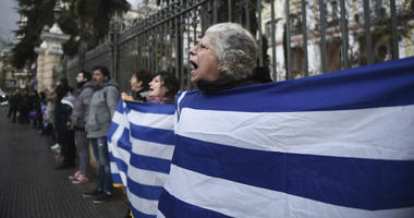 Holding Greek flags, opponents of Prespa Agreement chant slogans in a rally in the northern port city of Thessaloniki, Greece, Friday, Jan. 25, 2019.